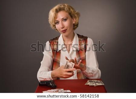 The pretty woman play poker - stock photo