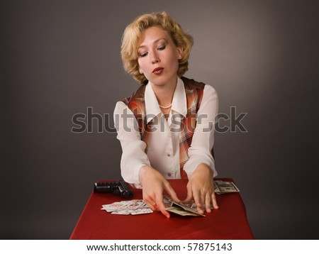 The pretty woman with cards - stock photo