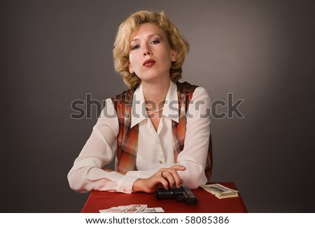 The pretty woman with cards on a grey background - stock photo