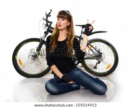 The pretty, young girl with bike. Isolated on white. - stock photo
