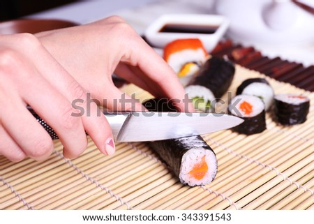 The process of making sushi and rolls - stock photo