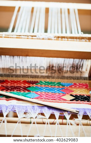 The process of manufacturing textiles on a loom - stock photo