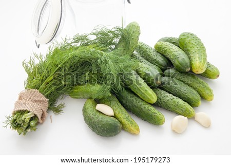The process of pickling cucumbers in the home kitchen - stock photo