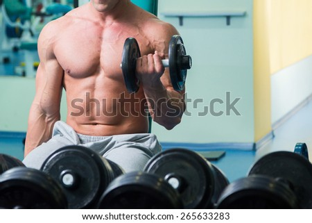 The process of power exercise. Sports. The process of exercises with dumbbells. Healthy lifestyle concept. Fitness, bodybuilding, strength, youth, health. - stock photo