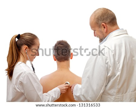 The professor teaches the young resident doctor - stock photo