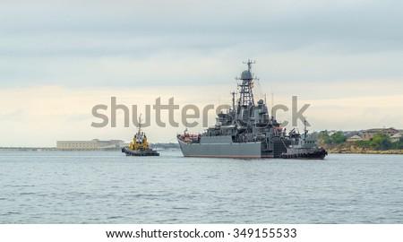 The Project 775 Ropucha Large Landing Ship (Bol'shoy Desatnyy Korabl', BDK) of Russian Navy. Evening in Sevastopol Bay of Black Sea. Republic of Crimea - stock photo