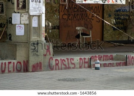 The protesters in downtown Oaxaca, Mexico have vandalized the downtown area to deter tourism and make a statement to the government. - stock photo
