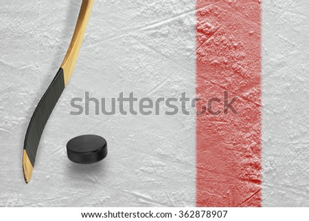 The puck, stick at the red line on a hockey rink. Texture, background - stock photo