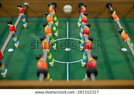 The puppets of Table soccer stand face to face in the center of the field prepare for competition - stock photo