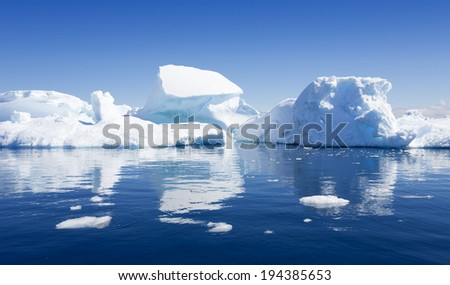 The purest waters of deep-water Antarctic fjords and crystal ice of subpolar areas. Research of a phenomenon of global warming. - stock photo