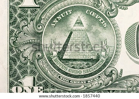 The pyramid and eye on the back of a one dollar bill. - stock photo
