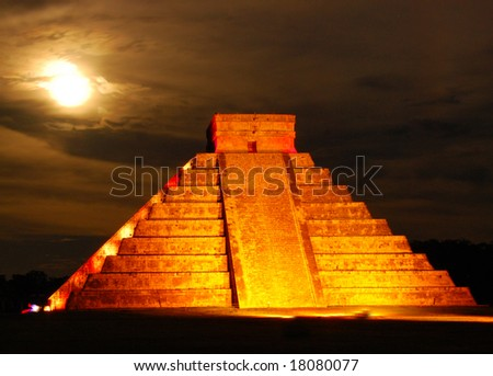 The pyramid of Kukulcan, often called El Castillo, at Chichen Itza, photographed under a full moon during a very special light show. - stock photo