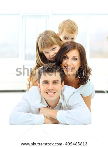 The pyramide of the smiling happy family - stock photo