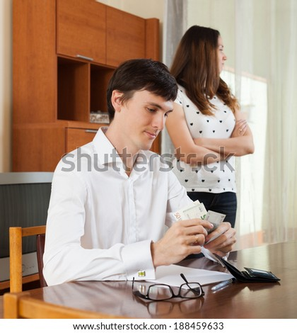 The quarrel in young family  having a financial problems - stock photo