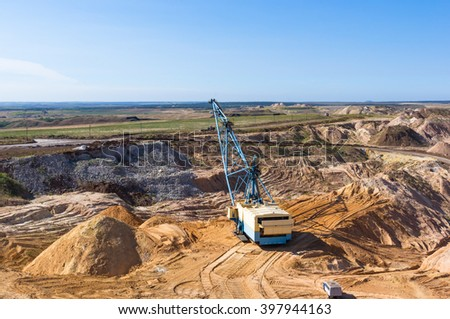 the quarry of the unique blue clay in bright summer day - stock photo