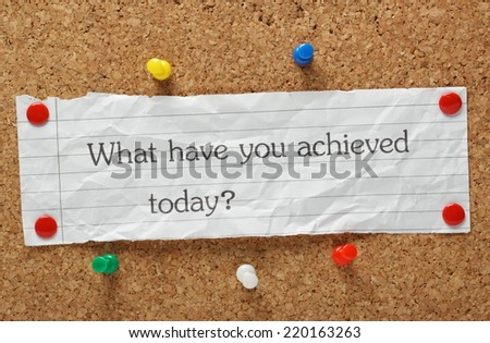 The question What have you achieved today? typed on a piece of crumpled paper pinned to a cork notice board - stock photo