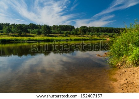 The quiet small river in summer day - stock photo