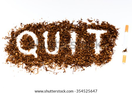 The QUIT text made from tobacco isolated on white background. Quit smoking addiction concept. Stop smoking message - stock photo