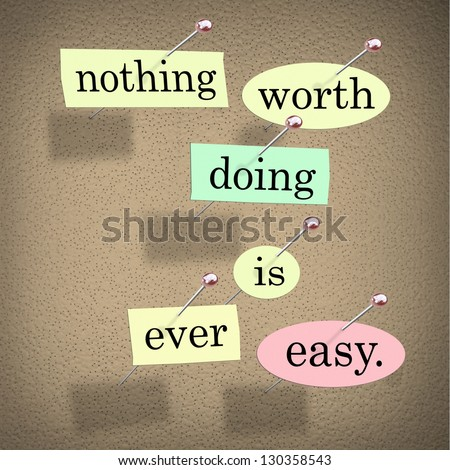 The quote or saying words Nothing Worth Doing is Ever Easy in pieces of paper pinned to a bulletin board to motivate or inspire you to succeed - stock photo