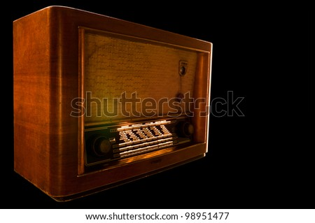 the radio playing on a black background - stock photo
