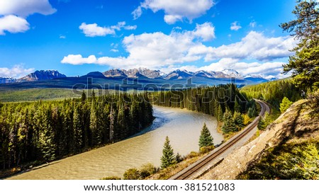 The railroad following Morant's Curve in the Bow River with Haddo Peak, Saddle Mountain and Fairview Mountain in the background in Banff National Park, Alberta, Canada - stock photo