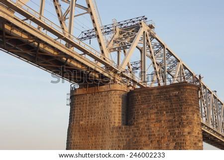 the railway bridge on the blue sky background - stock photo