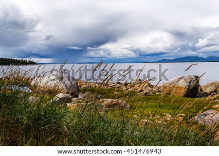 The rain with a thunder-storm passes over Kandalaksha bay the white sea in August - stock photo