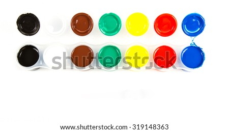 The range of different colors of paint gouache in containers . - stock photo