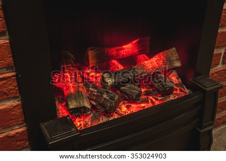 the real fireplace with the burning firewood and coal - stock photo