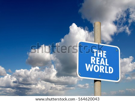 The real world signpost with blue sky and clouds - stock photo