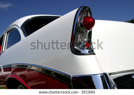 The rear end of a classic automobile. - stock photo