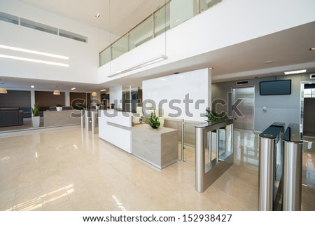 The reception at the entrance in a business center with modern style - stock photo