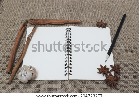 the recipe book with garlic, star anise. spice - stock photo