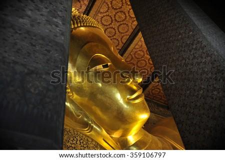 The reclining buddha at Wat Pho in Bangkok, Thailand. - stock photo