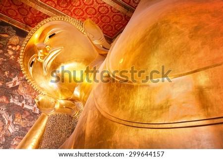 The Reclining Buddha at Wat Pho (Pho Temple) in Bangkok   - stock photo
