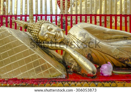 The reclining Buddha in Wat Doi Suthep , Chiang Mai , Thailand  - stock photo