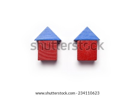 the red and blue wood blocks like house(real estate) isolated white, top view at the studio. - stock photo