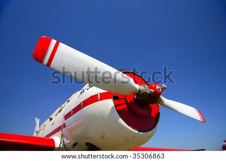 The red beautiful propeller of background blue sky - stock photo