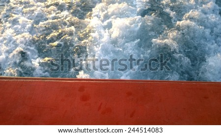 the red board is on the wave - stock photo