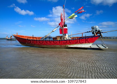 The red boat on the sand. - stock photo