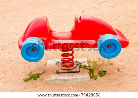 The red car is a car dock and play - stock photo