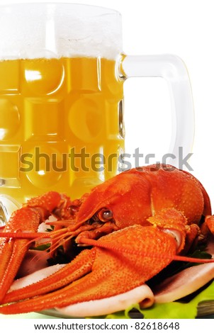 The Red crayfish on saucer and mug of beer. The White background. Isolated. - stock photo