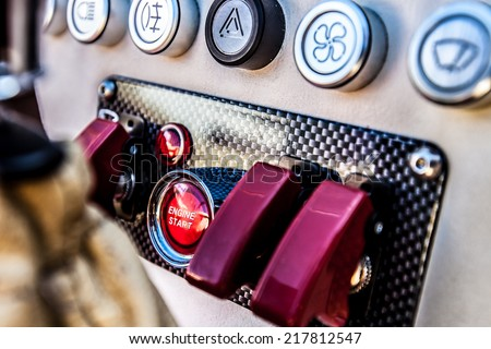The red 'engine start' button on a nitrous oxide equipped sports car in the UK. - stock photo