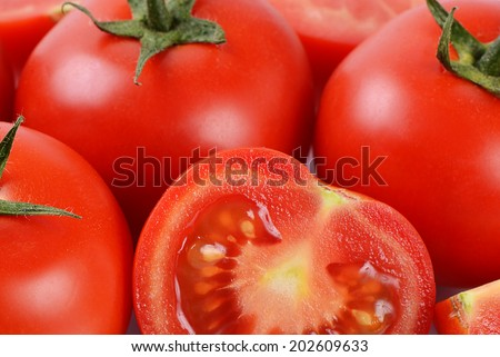 The red fresh tomatoes cut. Close up - stock photo