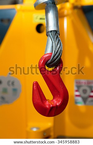 The red hook of the loading machine - stock photo