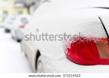 The red lamp of the car in snowy winter - stock photo