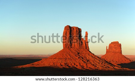 The red Mitten Buttes of Monument Valley at sunset. Arizona, USA - stock photo