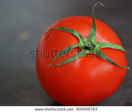 The red ripe tomato with green leaf . - stock photo