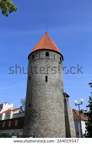 The red roofed medieval towers of the city wall of Tallinn, Estonia on the Baltic Sea - stock photo