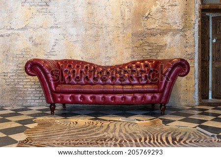 The red sofa  - stock photo